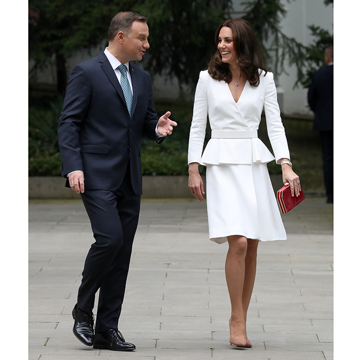 Duchess Kate, seen here with the Polish president, wore a white ensemble by one of her favorite designers, Alexander McQueen. 