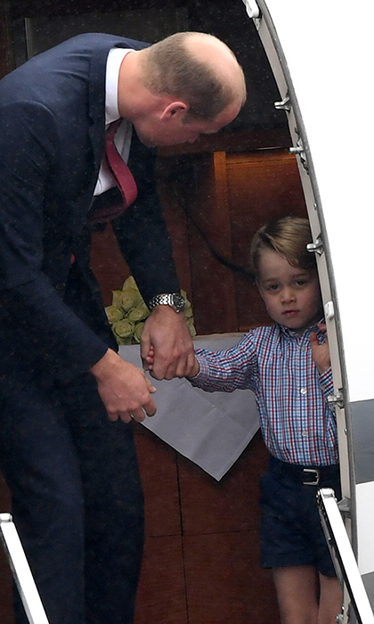 It appeared that Prince George, three, was reluctant to leave the plane, but his dad Prince William was there to help coax him out.