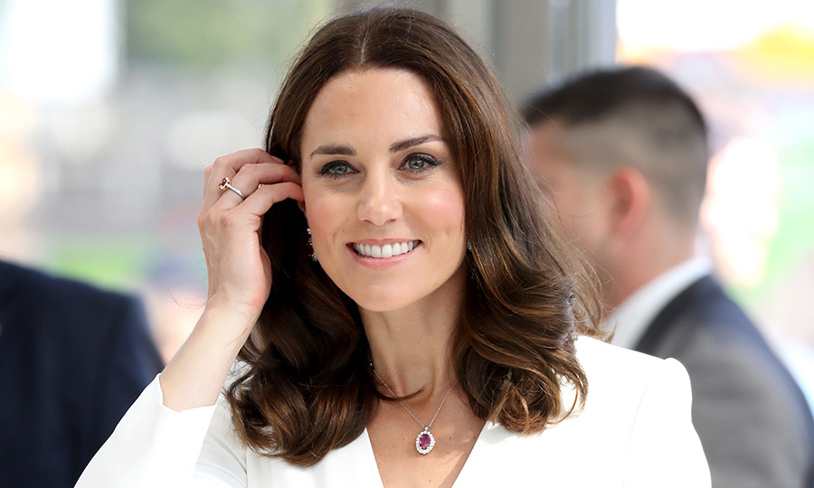 Kate's sapphire engagement ring is an iconic piece, but this time the royal opted to add rubies to her ensemble, including a pretty pendant and ring on her right hand.