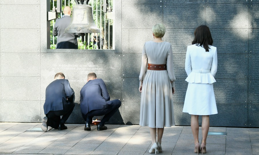 Kate and first lady Agata Duda looked on as William, who was joined by President Andrzej Duda, lit a candle at the Warsaw Rising Museum.