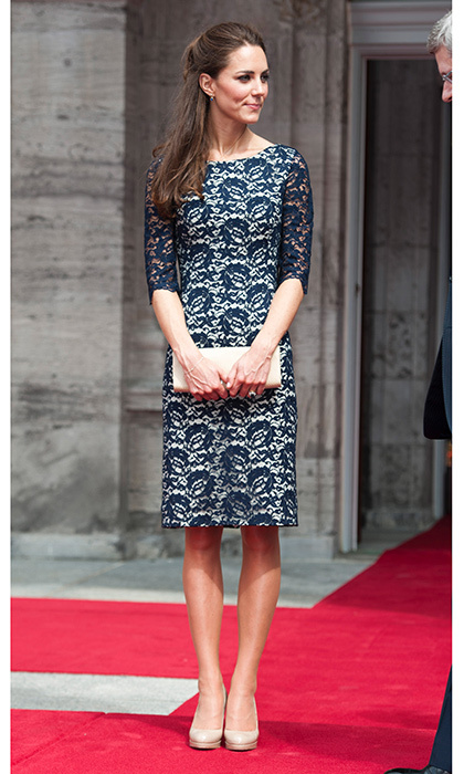 During her first appearance during 2011's royal tour of Canada, Kate sported a dark blue lace Erdem dress, accesorizing with a nude LK Bennett clutch and heels. 