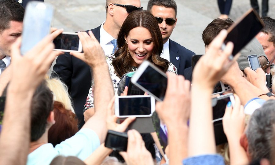 The Duchess was greeted by a number of fans and their phones upon her arrival to the town market in Gdansk.