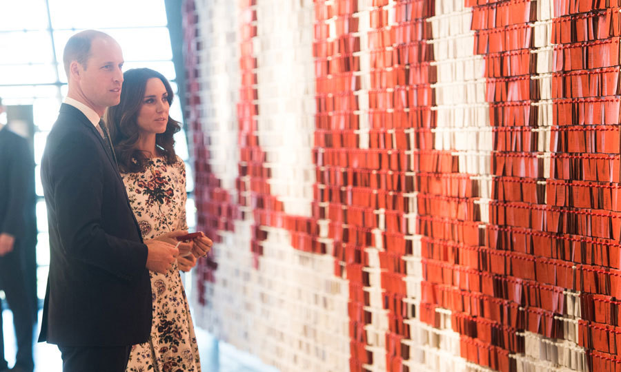 Princess Charlotte's mom and dad toured the European Solidarity Centre, where they placed cards on a solidarity wall that is covered in personal messages from the public.