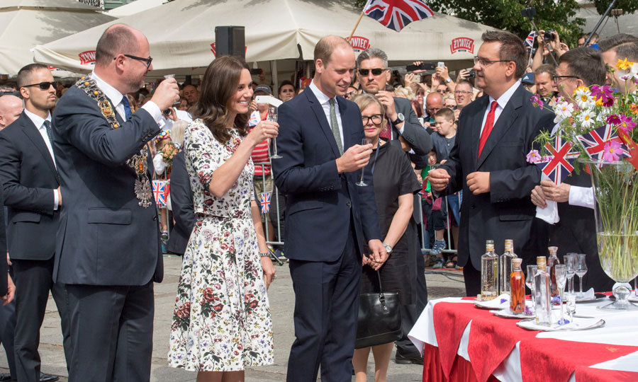 Cheers! The Duke and Duchess of Cambridge tried some Polish and Gdansk delicacies at a street party, including Goldwasser, which is a traditional liqueur with flakes of gold and some pierog.