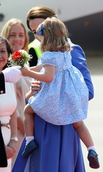 While only two-years-old, Princess Charlotte is proving to be a master of diplomacy. The Queen's great-granddaughter shook hands with a defense attaché at Berlin Tegel Airport as her mother proudly looked on.