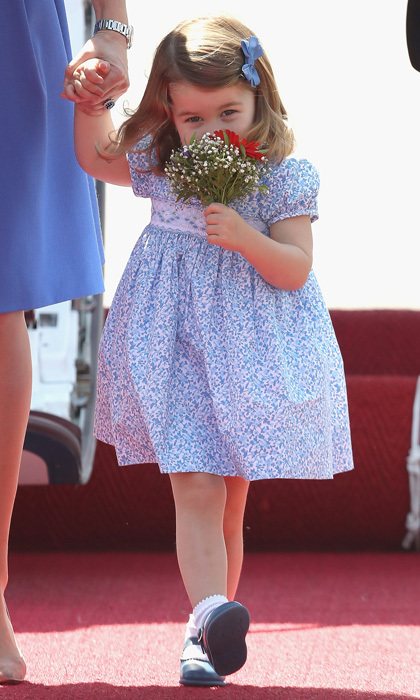 Charlotte looked angelic smelling her flowers after receiving her first official bouquet in Berlin.