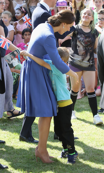 During her visit to the Strassenkinder charity, which supports young people from disadvantaged backgrounds, Kate received a warm hug from a fan, who was holding a photo of the Duke and Duchess of Cambridge from their wedding day. Strassenkinder cares for 200 children daily, providing welfare assistance, education and sports activities.