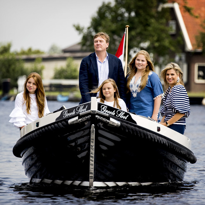 King Willem-Alexander and Queen Maxima were joined by their daughters Crown Princess Catharina-Amalia, 13, Princess Alexia, 12, and Princess Ariane, ten, at Kaag Lakes in South Holland for their annual summer photocall. The popular boating area served as the perfect backdrop for the Dutch royal family's photo session, which is one of two yearly photo opps that the royals partake in with the press.