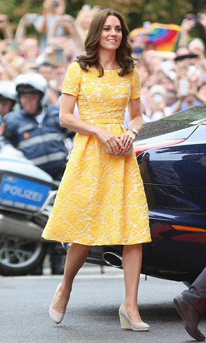 The Duchess of Cambridge had continued her colorful style streak that morning in Heidelberg. Kate turned heads in a sunflower yellow lace fit and flare dress from Jenny Packham – one of her fave designers – as she joined her husband Prince William at the German Cancer Research Center.