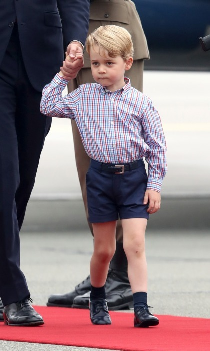 Just ahead of his fourth birthday on July 22, Prince George debuted a new look on his second royal tour when he arrived in Warsaw, Poland. The future king changed up his look on Monday, July 17 sporting ankle socks with a plaid, button-down shirt, navy shorts, and his Start-Rite's John shoes.