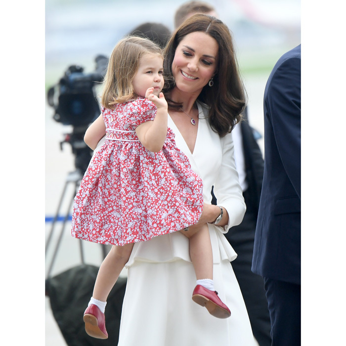 Princess Charlotte gave a royal wave as she arrived on her second tour with her parents and brother to Warsaw, Poland on July 17.