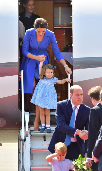 Princess Charlotte had a helping hand from her mom as she walked down the steps of their private plane in Berlin during the second stop of their royal visit to Poland and Germany in July 2017.