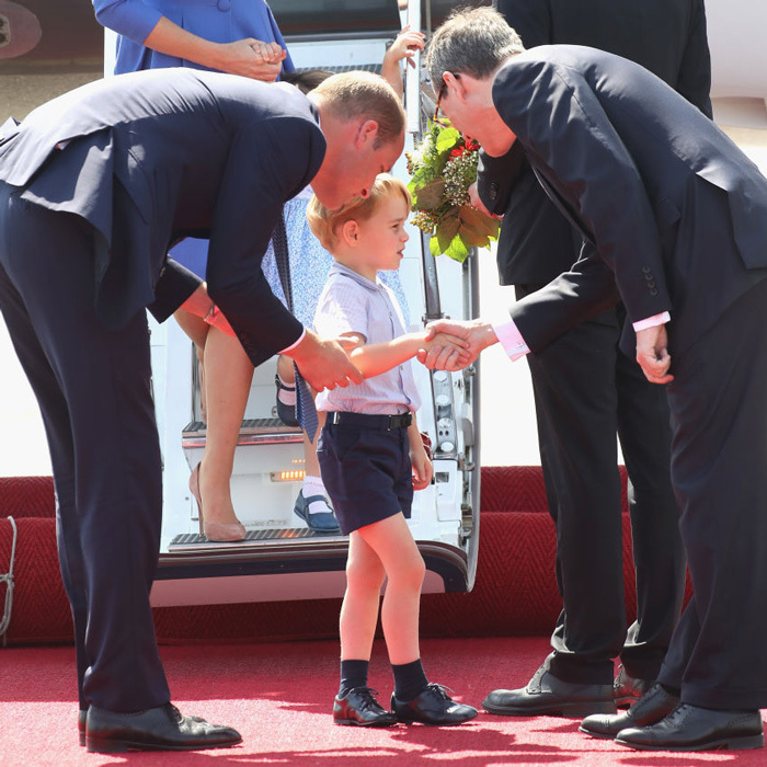 Prince William looked on as Prince George greeted dignitaries upon arrival to Berlin from Warsaw on July 19. The visit was to Germany was the second stop of their second royal tour as a family of four.