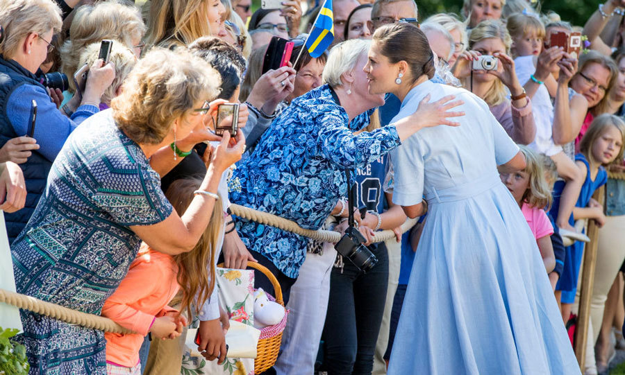 Crown Princess Victoria was given a sweet embrace and kiss during her 40th birthday celebration in Borgholm, Sweden.