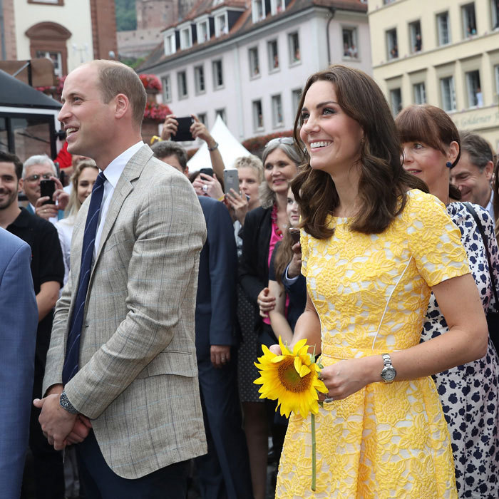 Kate added a sunflower to her sunny look on July 20.