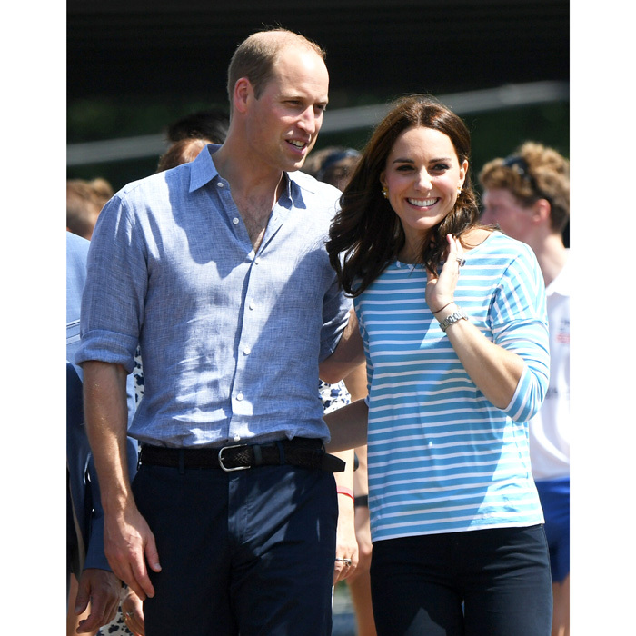 The pair shared a rare moment of PDA after Prince William beat his wife in the rowing race.