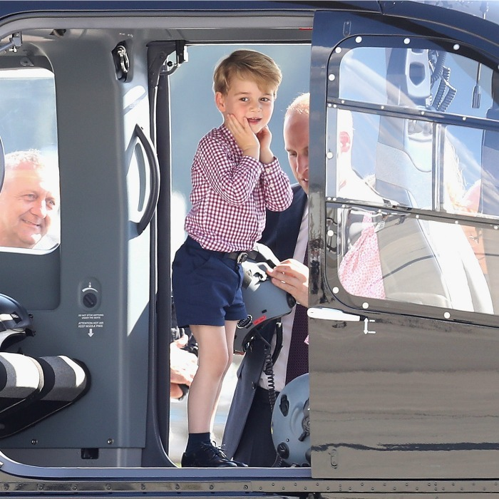 Future pilot! Prince George was in his element as he stood inside of one of the helicopters while William prepared to put a helmet on his head.