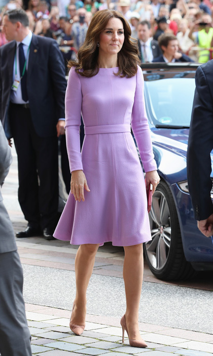 The Duchess looked lovely in lavender for the final day of her royal tour of Germany. The royal opted for a bespoke dress by Emilia Wickstead that featured long sleeves and a set-in waistband for her July 21 trip to Hamburg. Kate accessorized her look with a red Anya Hindmarch snakeskin clutch, her Kiki McDonough lavender amethyst pear and oval drop earrings and her trusty Gianvito Rossi praline pumps.