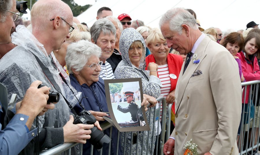 A wellwisher greeted Prince Charles with a photo of his son Prince Harry during the Sandringham Flower Show in King's Lynn, England on July 26. 