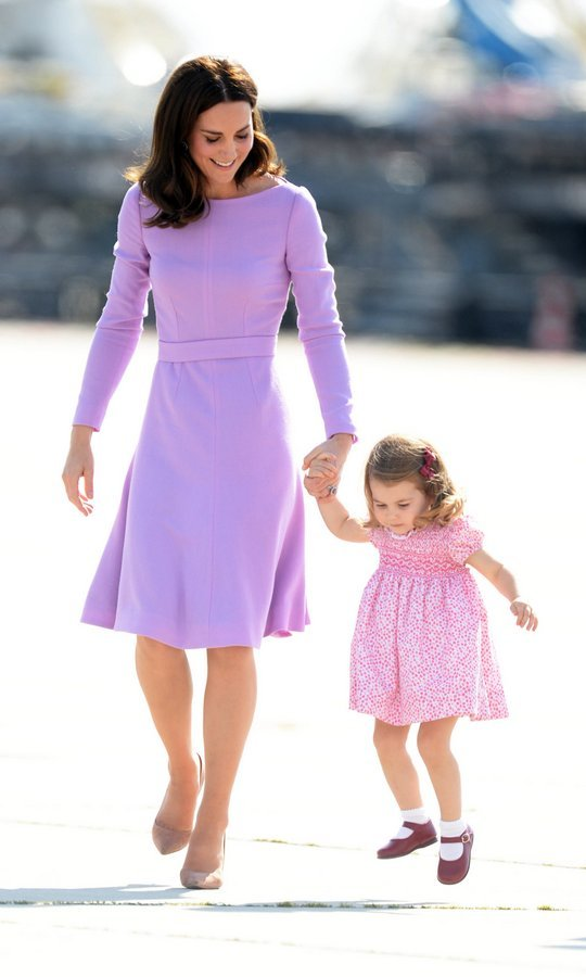Duchess Cambridge couldn't help but smile when daughter Princess Charlotte took a leap as the Cambridges prepared to head home from their five-day tour of Germany and Poland.