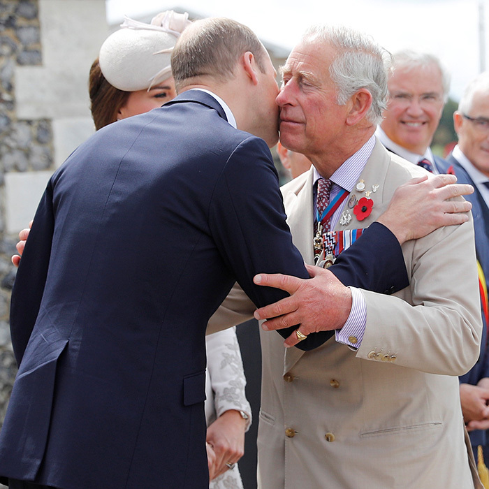 The Prince of Wales also had a warm embrace for his elder son Prince William as he arrived. 