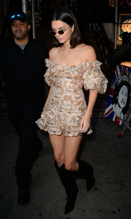 Model Kendall Jenner dazzled in a Boho-chic peach number while out in SoHo, NYC with her sister Kim Kardashian. She chose a long pair of black boots to go with her short frock.