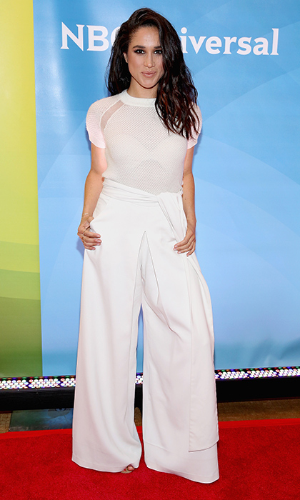 High-waisted trousers and a sheer knit top were the fashion-forward formula for an appearance at an NBC event in New York City.