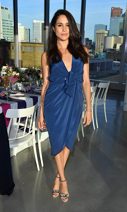 Blue is one of Meghan's fave hues – here she is in a silk halter dress in a shade that is also favored by the Duchess of Cambridge.