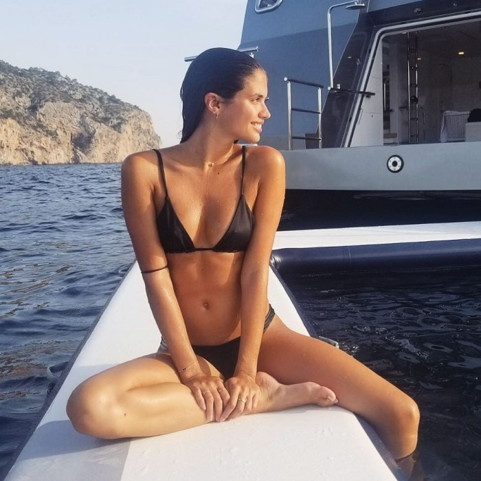 She reigns in Spain! Sara Sampaio looked stunning in a bikini while enjoying the islands of Mallorca. The 26-year-old Victoria's Secret model showed off her tone figure as she floated on a yacht.