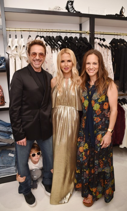 Peekaboo! It looks like Robert Downey Jr. got photobombed by a little friend while he was out supporting his pal Rachel Zoe's new shop. The syllist launched her What Goes Around Comes Around pop-in store in East Hampton on August 4.