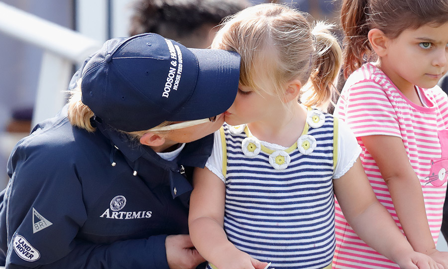 Queen Elizabeth's granddaughter Zara Tindall gave her adorable little girl Mia a smooch during the Festival of British Eventing on August 5.