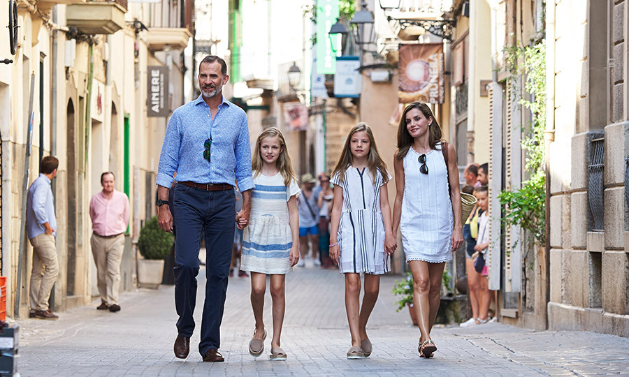 Even royals love sightseeing! King Felipe VI and Queen Letizia of Spain and their daughters Princess Leonor, center left, and Princess Sofia, center right, headed through the streets of Palma de Mallorca to visit the Can Prunera Museum on August 6.