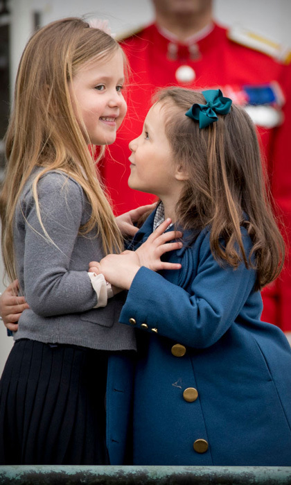 Princess Josephine and her younger cousin Athena cuddled close during their grandmother's 77th birthday outing in Aarhus, Denmark.