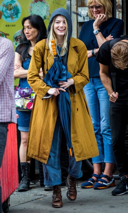 Emma Stone stayed dry as she filmed scenes for the new Netflix series <i>Maniac</i> in NYC on August 14.