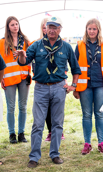 Sweden's King Carl XVI Gustaf showed his outdoorsy side as he attended the Scouts Jamboree in Kristianstad on August 11. 