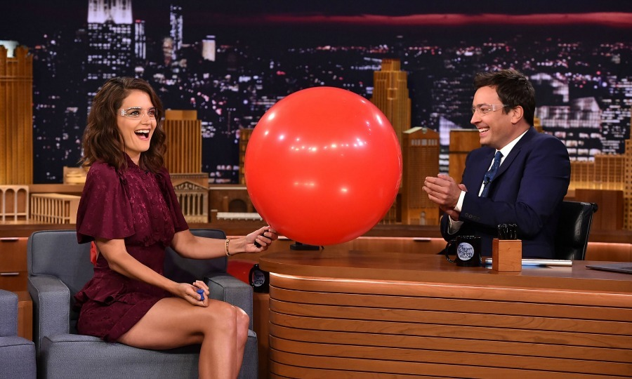 "Katie Holmes – who wore a Mayle dress – stopped by <i>The Tonight Show with Jimmy Fallon</i> and had some fun with balloons. The <i>Logan Lucky</i> actress opened up about fighting with her co-star Channing Tatum saying, ""We worked together before and we played a married couple who were fighting all the time and in this movie we're ex's and fighting. I'm like, can we do something where we are not fighting.""