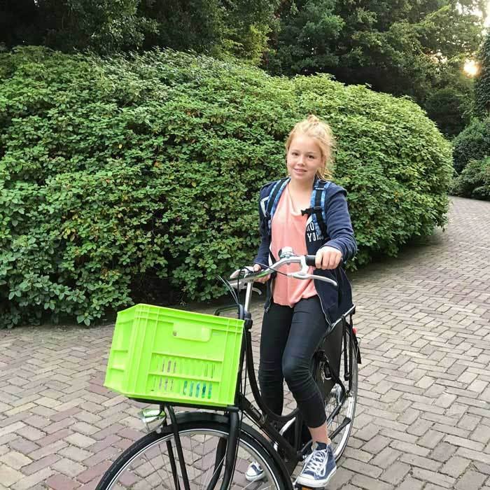 King Willem-Alexander of the Netherlands proudly snapped a photo of his 12-year-old daughter Princess Alexia bike-riding off to her school Christelijk Gymnasium Sorghvliet in the Hague on August 21.