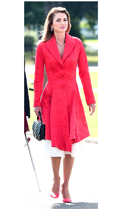 Queen Rania was regal in red at Sandhurst on August 11, when her son Crown Prince Hussein was one of the cadets being commissioned as an officer.