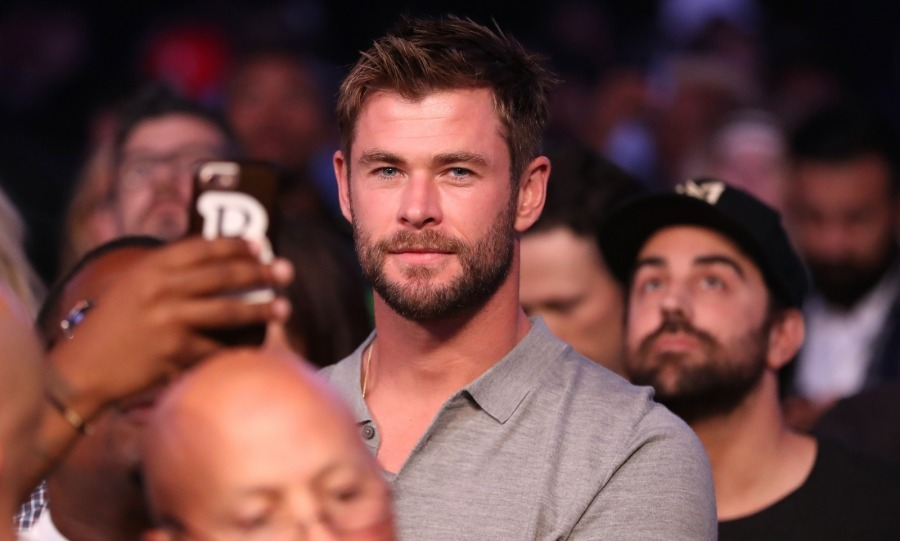 Charlize's <i>Snow White and the Huntsman</i> co-star Chris Hemsworth was also seen at the match watching intently from the front row. 