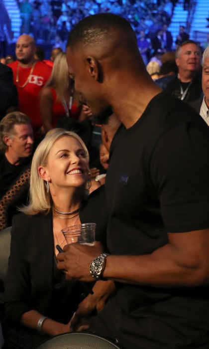 Jamie Foxx caught up with his buddy Charlize Theron prior to the two athletes touching gloves.