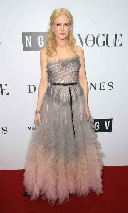 Glamorous homecoming! A-lister Nicole Kidman stunned on the red carpet at the National Gallery of Victoria Gala in Melbourne, Australia on August 25. The 50-year-old donned a chic pale grey and pink number that boasted a multitude of sheer feathered layers.