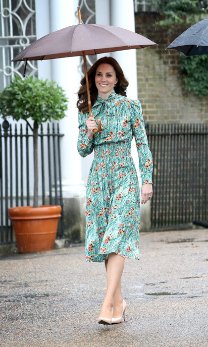 The Duchess of Cambridge joined her husband Prince William and brother-in-law Prince Harry in honoring Princess Diana on the eve of the 20th anniversary of her death. Kate looked chic wearing a Prada poppy print silk dress that featured smocking at the waist and a pussy bow. 