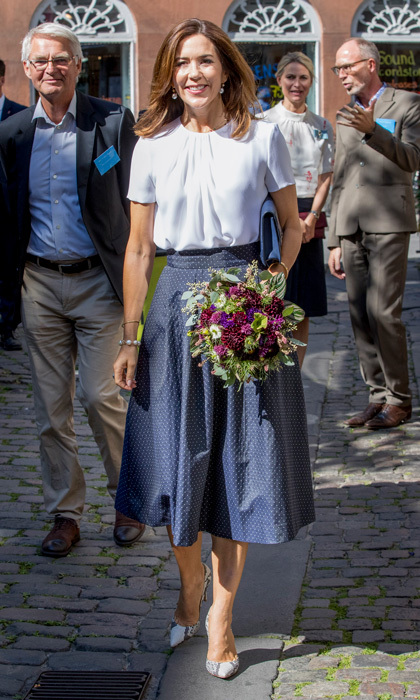 Crown Princess Mary of Denmark exuded femininity wearing a blue skirt and white top for the opening of the National Care Center on August 29 in Copenhagen.