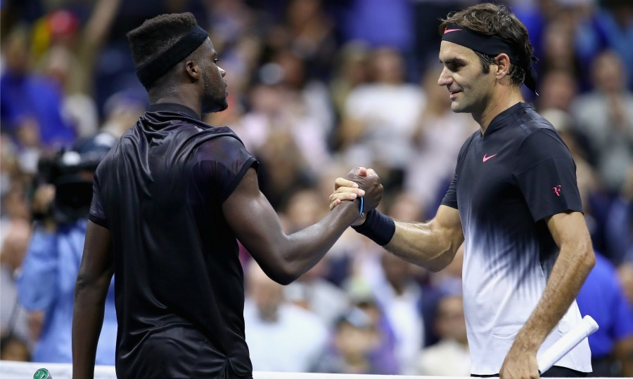 Roger Federer embraced competitor Frances Tiafoe after he won the Men's Singles Match.