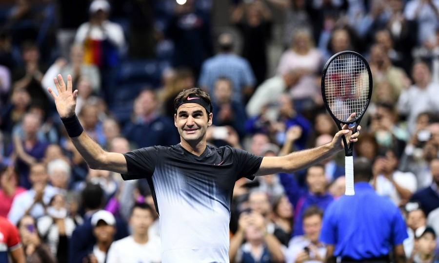 The Swiss tennis star celebrated his win with the crowd at the USTA Billie Jean King National Tennis Center.