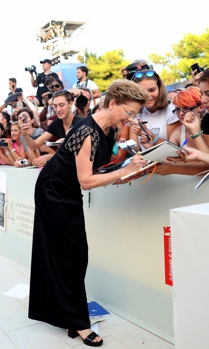 All hail the President! Annette Bening, the main jury president at the festival, took the time to sign autographs for fans as she walked the red carpet ahead of the <i>Downsizing</i> screening and Opening Ceremony. The Hollywood star was classic in Giorgio Armani.