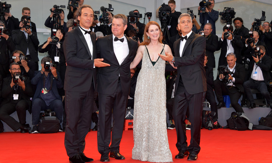 Julianne Moore, in Valentino, was quite the lucky lady among some dapper gentleman (Alexandre Desplat, Matt Damon and George Clooney) at the <i>Suburbicon</i> premiere.