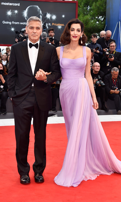 For their return to the red carpet since welcoming twins Alexander and Ella in June 2017, Amal stunned in a Versace lilac gown as George looked dapper in a black tuxedo during the <i>Suburbicon</i> premiere at the Venice Film Festival.