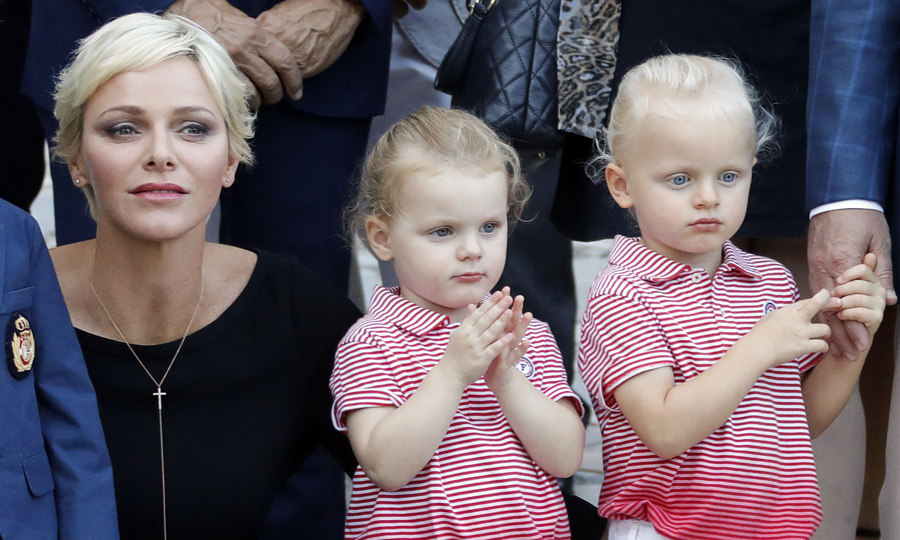 Princess Gabriella (L) and Prince Jacques clapped and admired the entertainers during the picnic. The event which is thrown by the City Council of Monaco featured folk dancers, a Mass and barbecue. 