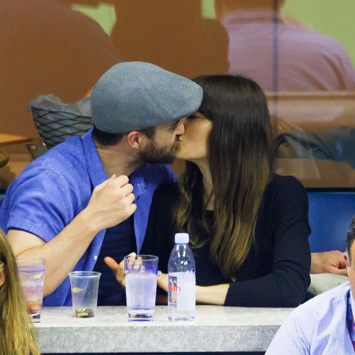 The couple, who left their son Silas at home, stole a kiss from the ESPN suite as well during the Saturday night match.